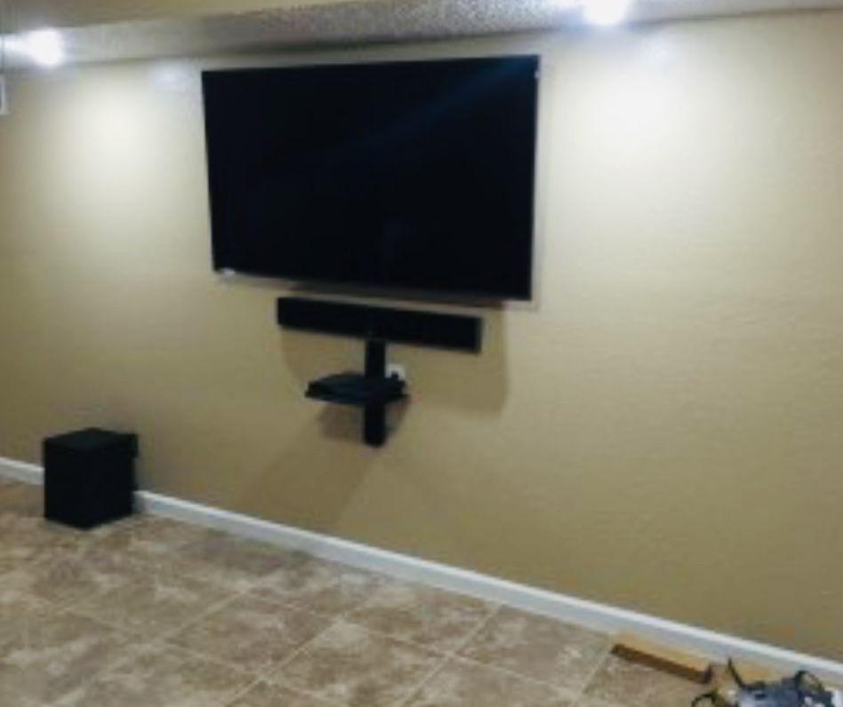 TV, Sound Bar, and Floating Shelf Mounted