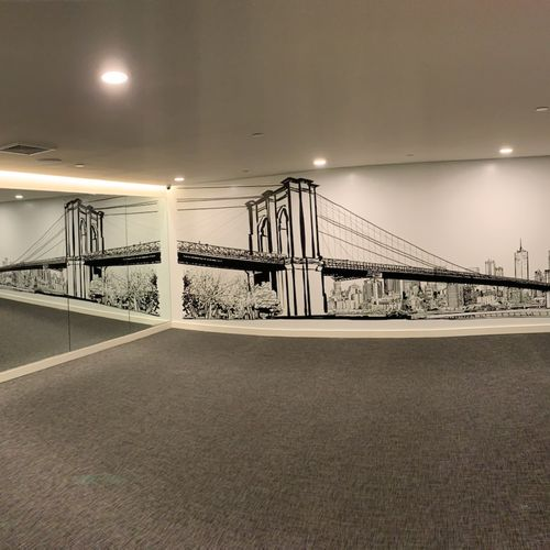 An inspirational wall with a mural, like the one in the photo done for a Gym, one of our clients!