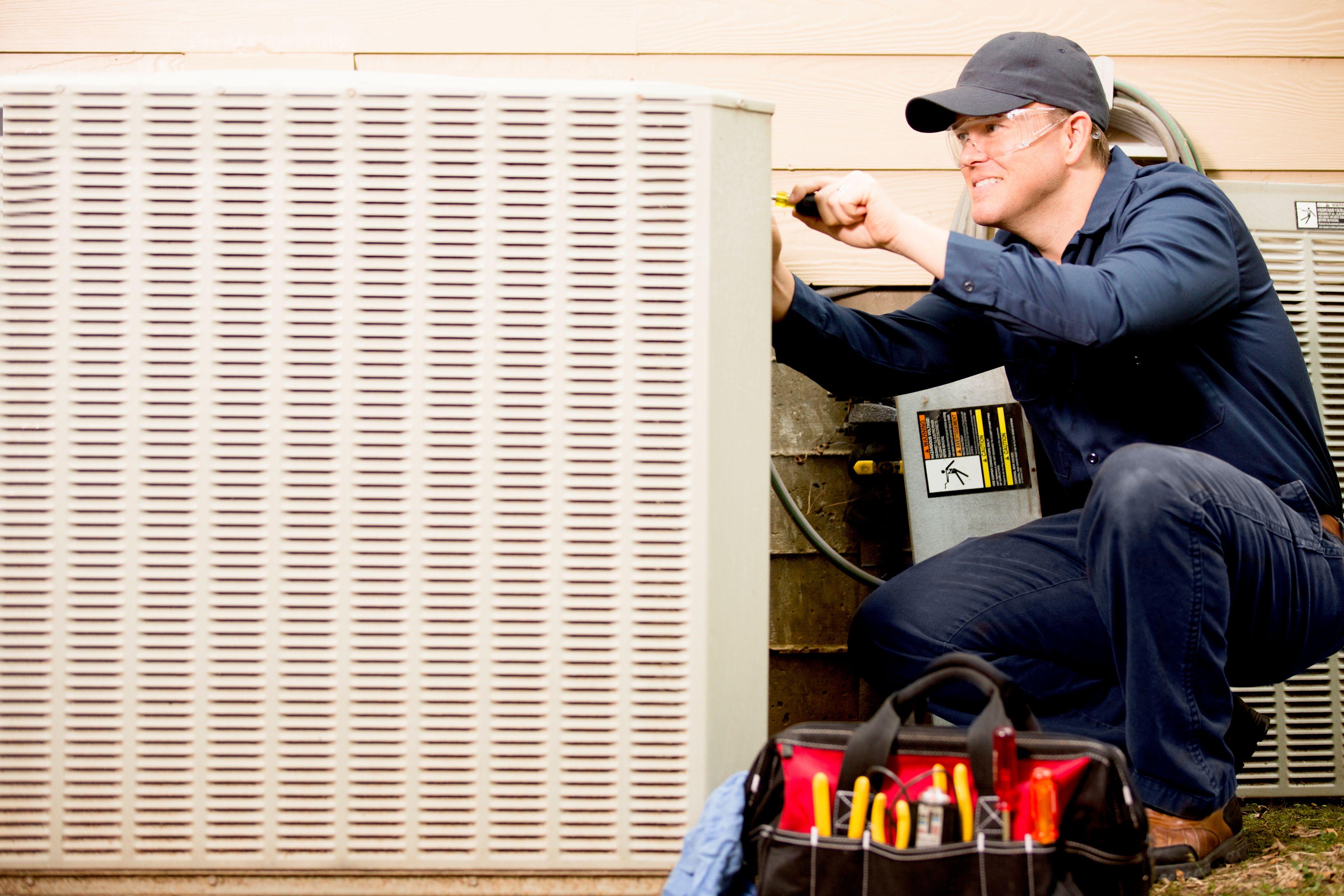HVAC technician working on AC
