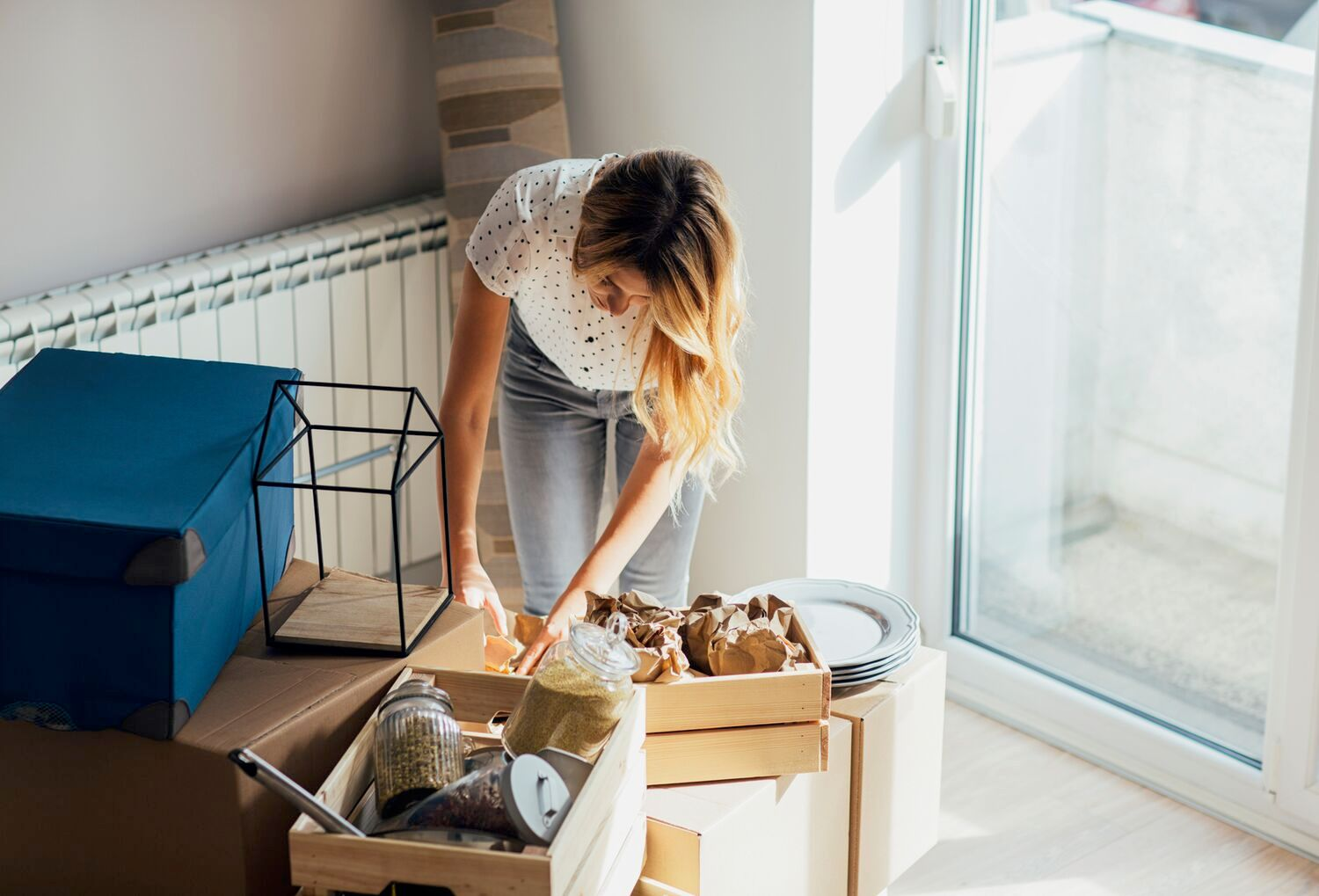 woman sorting items into boxes