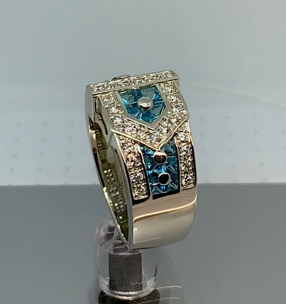 Custom white gold, teal topaz and diamond buckle ring