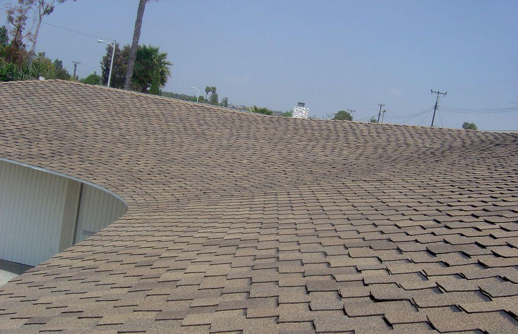 Asphalt shingle roof insulation