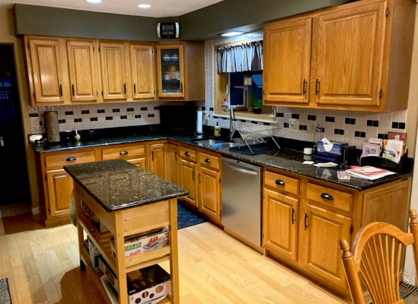 Kitchen cabinets from light oak to white