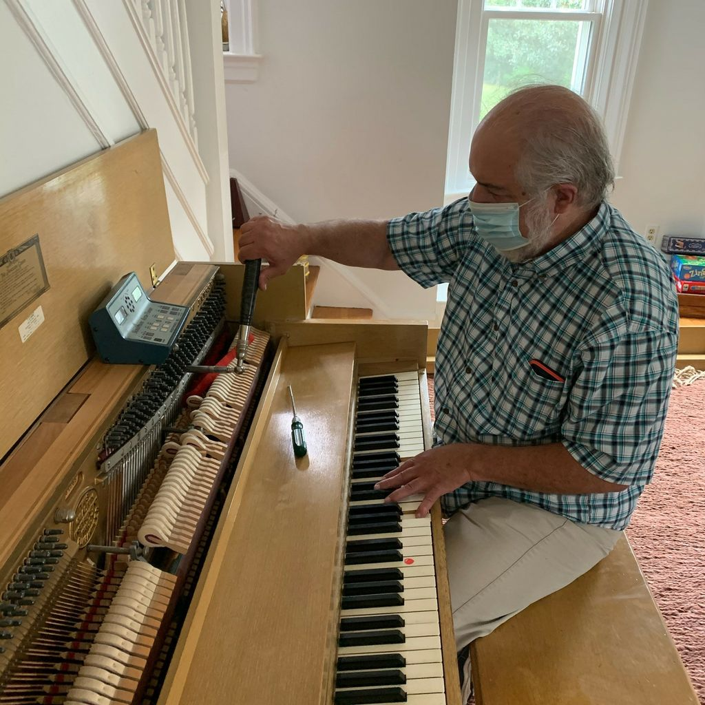 Piano Tuning and Repairs by Marty Krzywonos