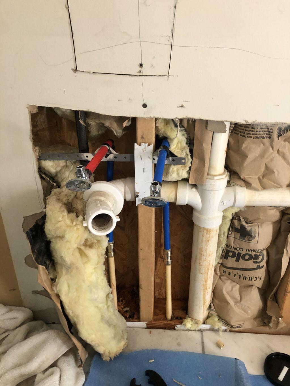 Broken pipes behind vanity