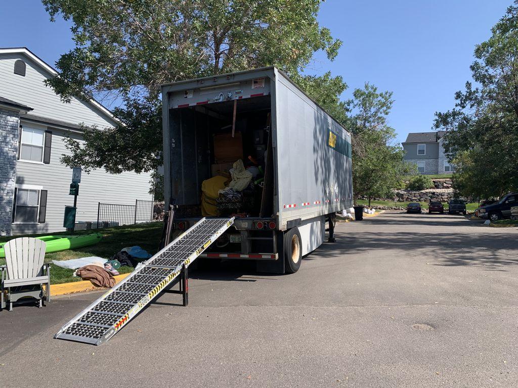 Unloading 26 ft Trailer 2 crew members