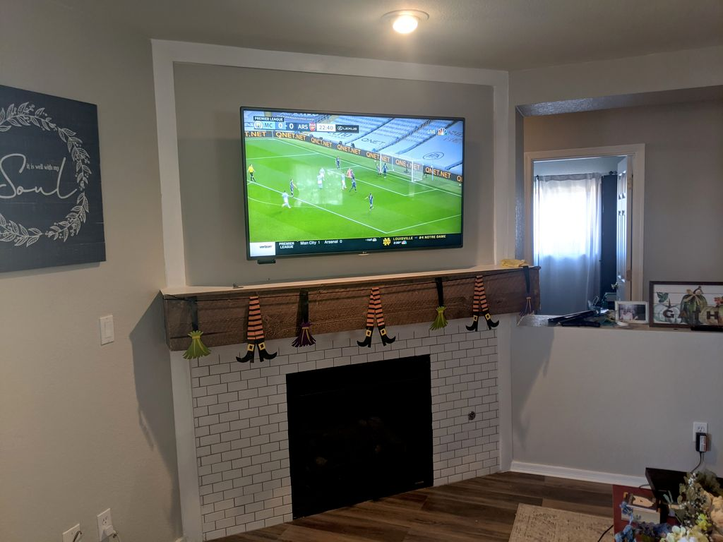Fire place hang with cable and power relocation