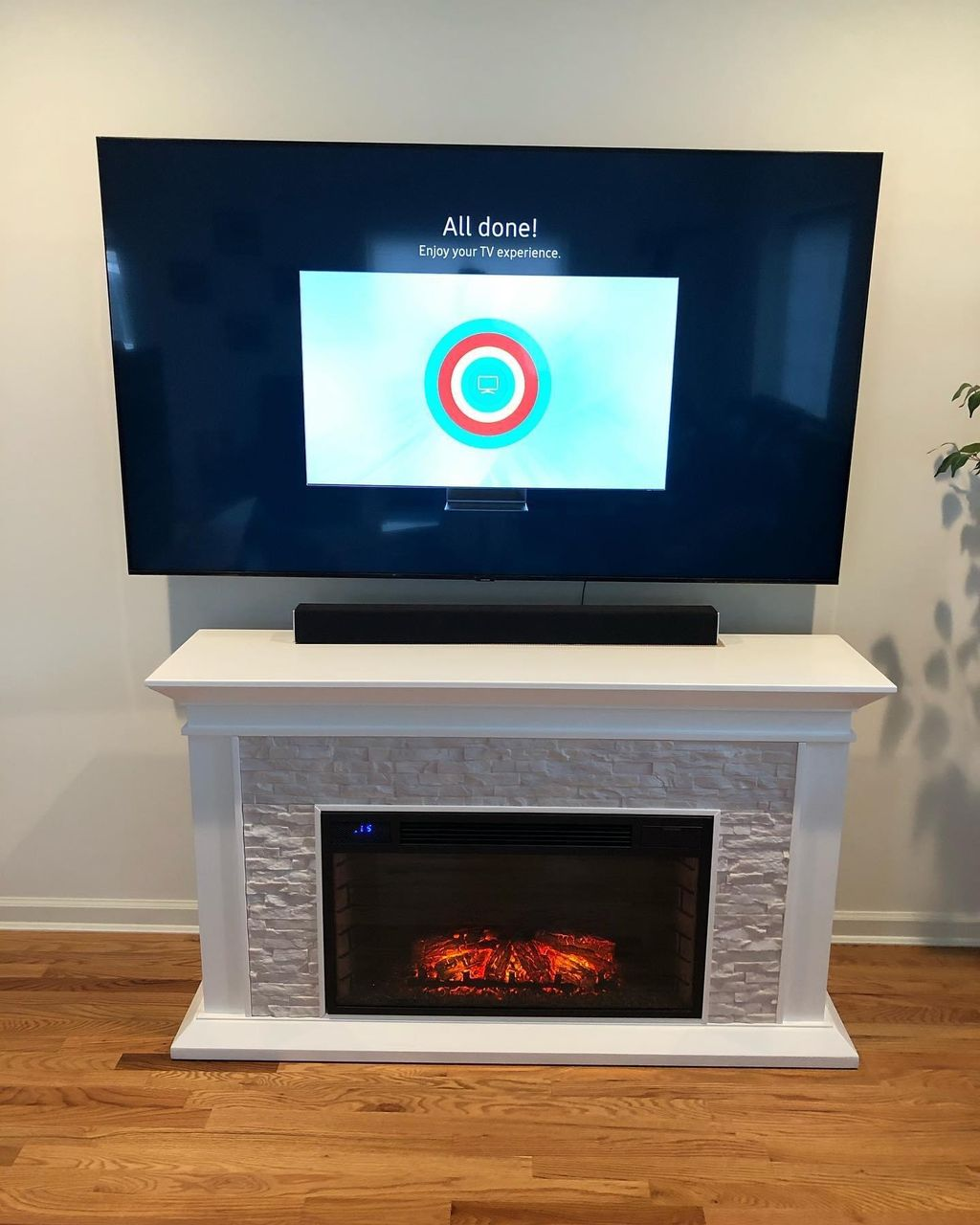 65 Samsung tv wall mount and fireplace assemble