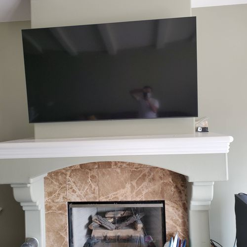 70 inches TV above fireplace