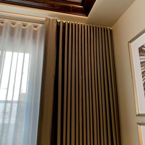 Custom ripplefold ceiling track-mounted draperies. Custom made here in Denver!