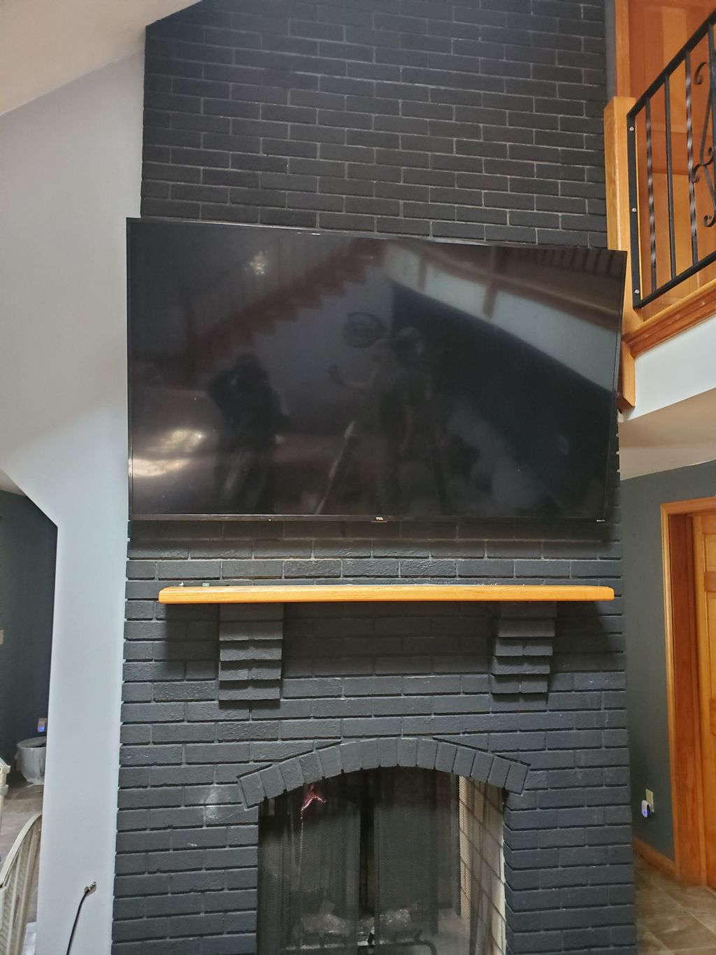 Tv mounting over fireplace 12 feet high