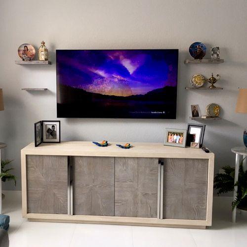 Hung up tv & side shelves