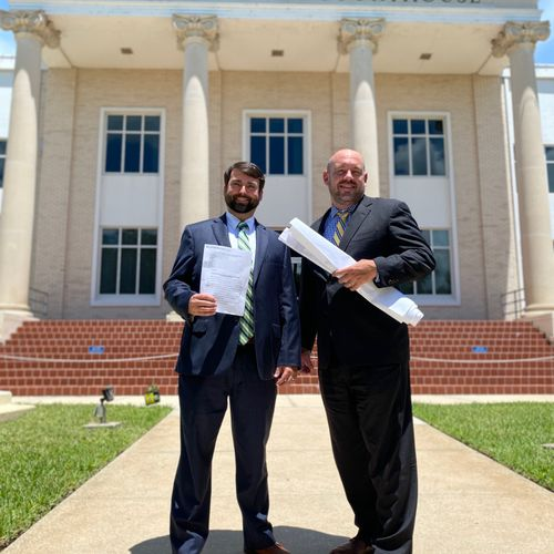 Attorneys Charlie Douglas and Lex Taylor after winning an eminent domain case!