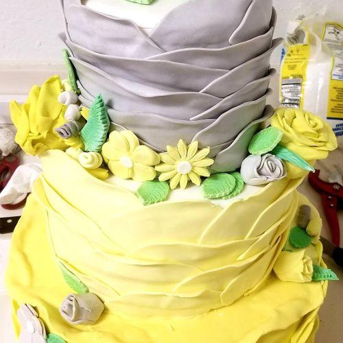 yellow and gray ruffled wedding cake!