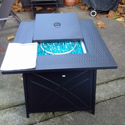 Outdoor fire pit with blue fire glass