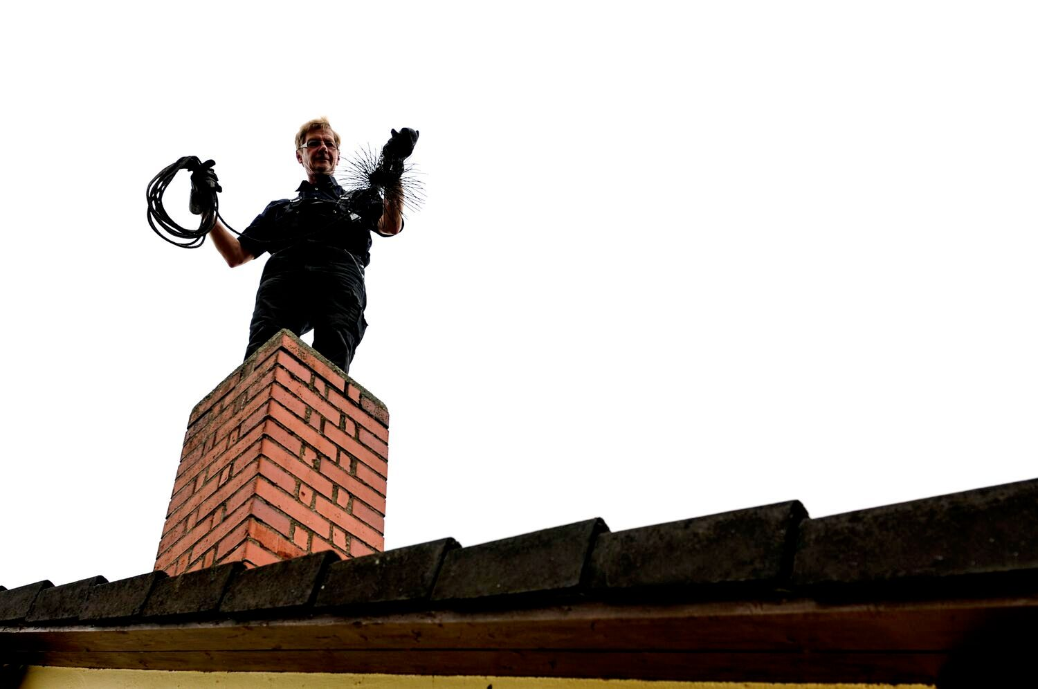 chimney sweep on roof