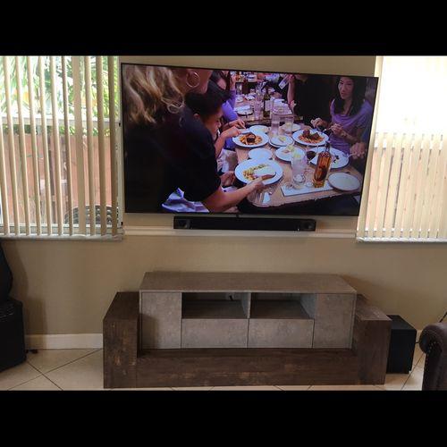 Mount tv sound bar & built the entertainment system.