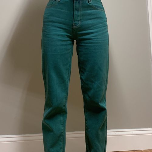 Jeans (After)  Alterations done: - Tapering of waist ($20.00),  -Tapering legs ($25.00) Discounted price ; $40.00