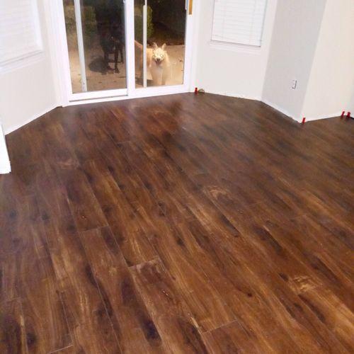 vynil plank flooring on black insulated subfloor