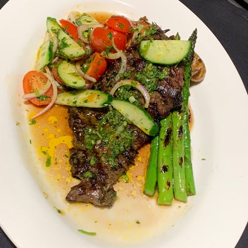 Grilled Skirt Steak, Asparagus, Cucumber salad and Crushed Fingerling Potatoes.