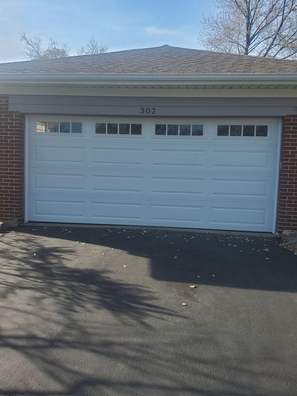 New CHI 4283 garage door with Madison Glass