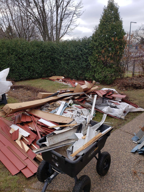 Junk removal-old siding 3 pick up loads