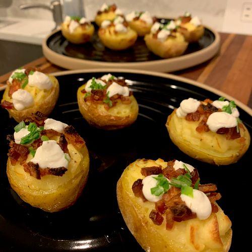 Twice baked Yukon potatoes, smoked bacon, scallion, onion creme fraiche