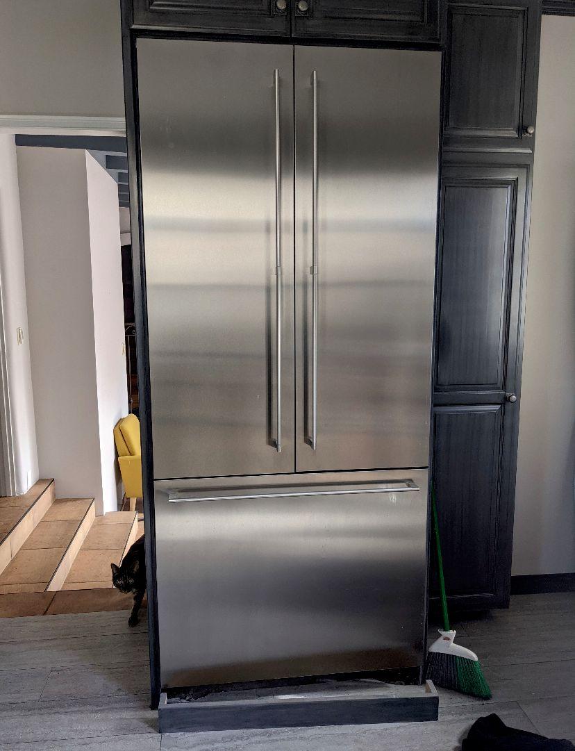 Oversize refrigerator & A custom cabinet