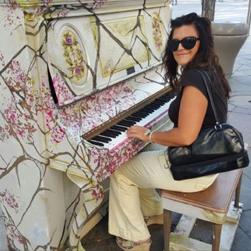 """""""Keys to the City"""" Program bringing music to everyone. Volunteer painting a piano to be played by pedestrians, 16th Street Mall in Denver"""