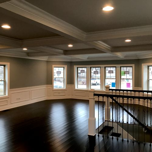 Full gut rehab with coffered ceilings and wainscotting