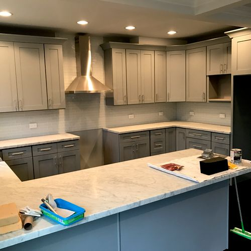 Modern Shaker cabinets and a Marble countertop.