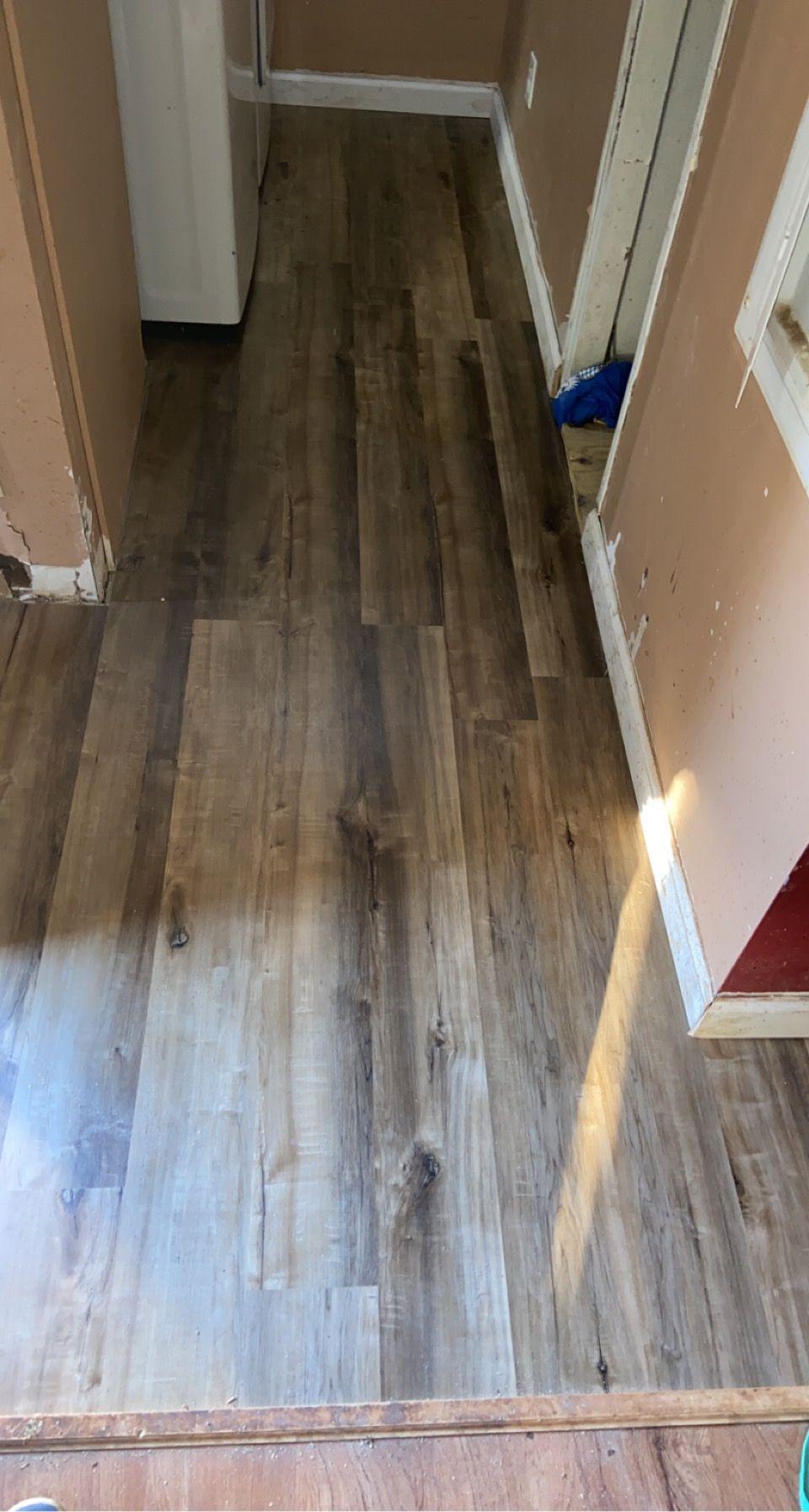 Replace subfloor and add vinyl floors
