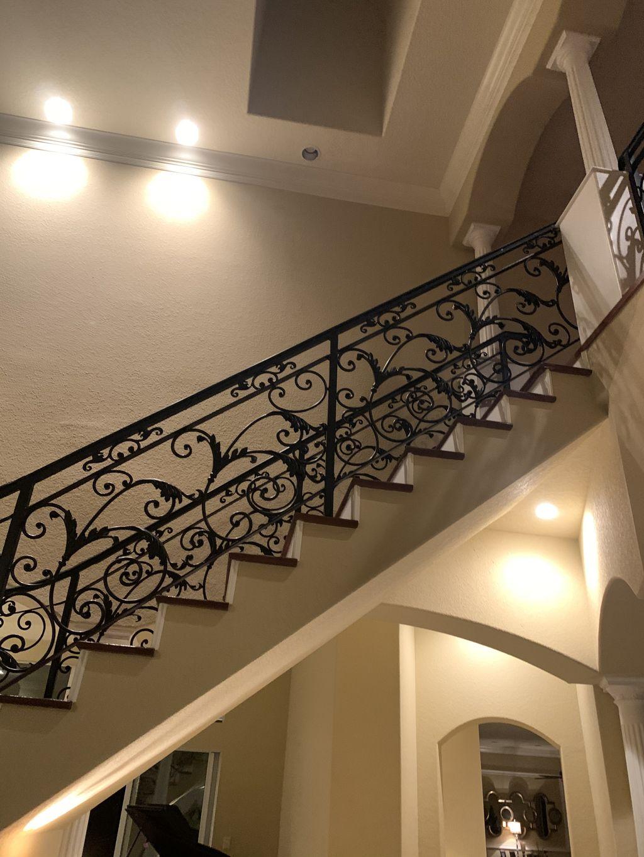 Ornamental iron, curved stair railing