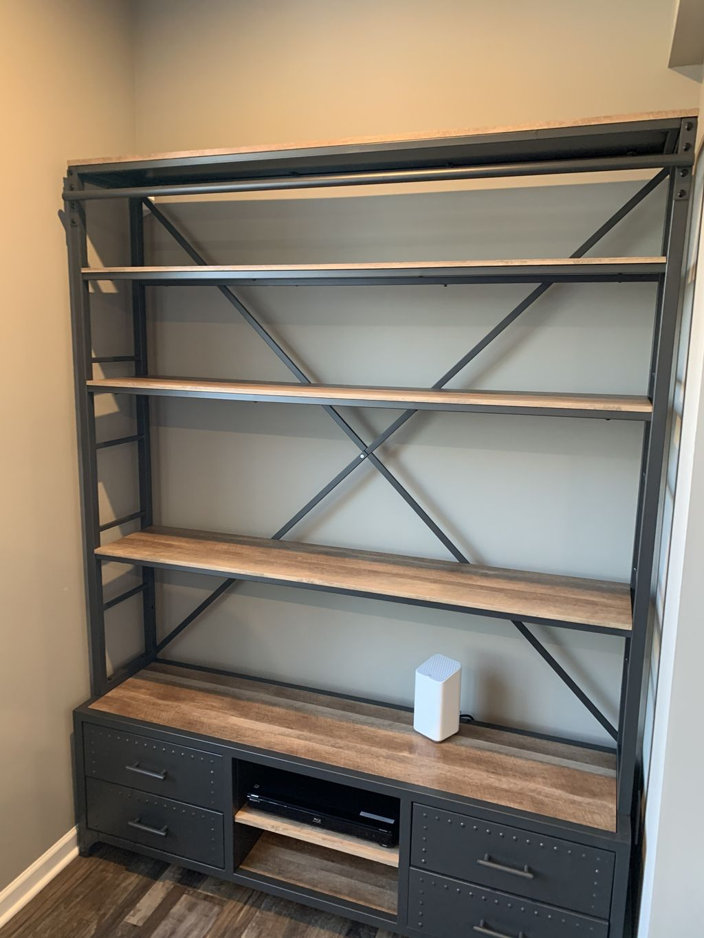 Double tiered bookshelf with sliding ladder