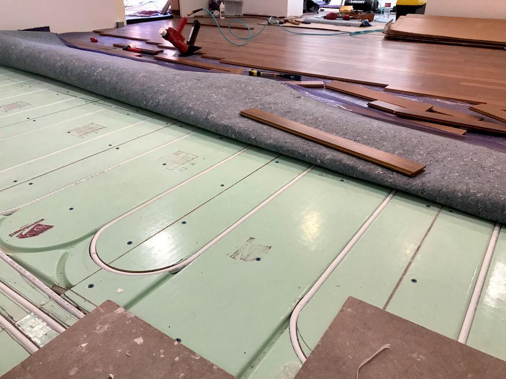 Install hardwood floor over heating floor