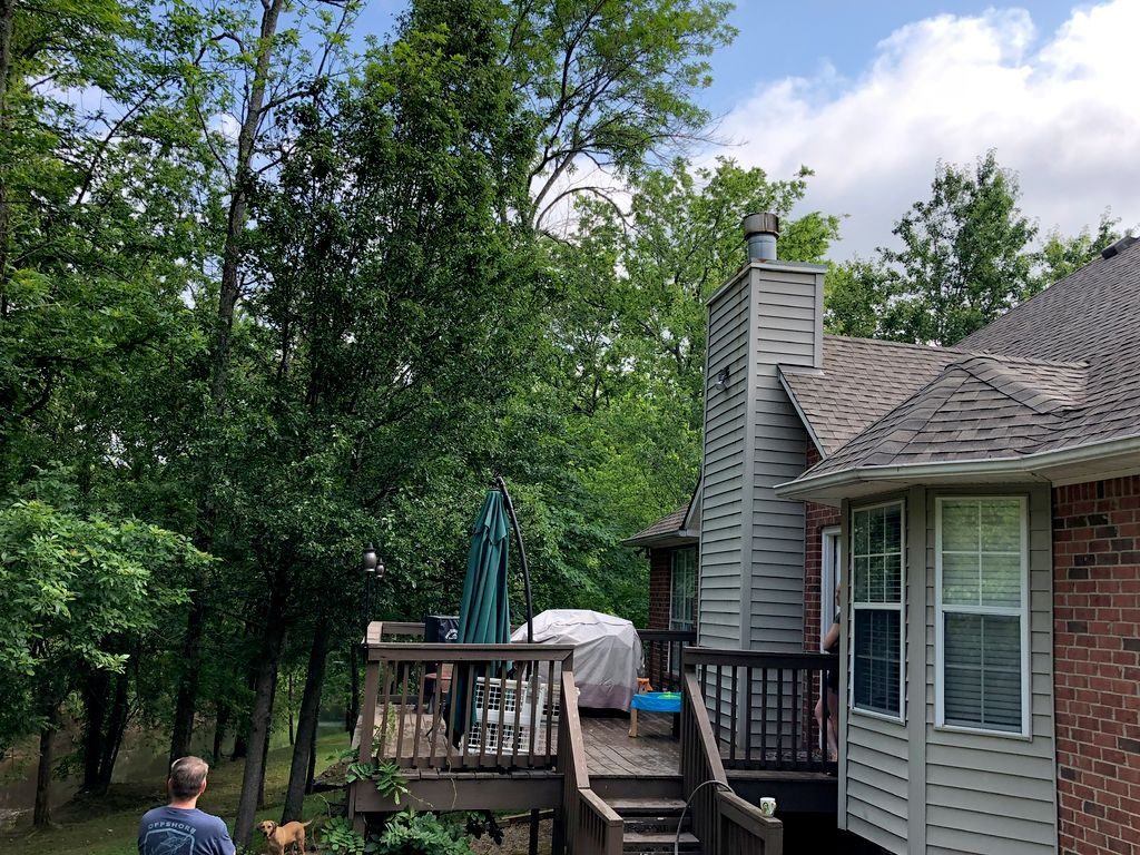 Covered screened deck extension