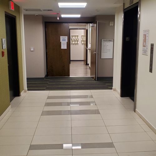 After coming out of the 4th Floor elevators, turn left before the Shared Kitchen/Lobby Area double doors for East Wing entrance.