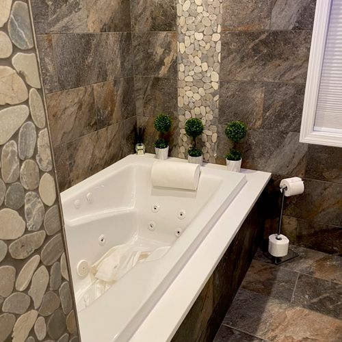 Full basement bathroom with jacuzzi and stand up shower