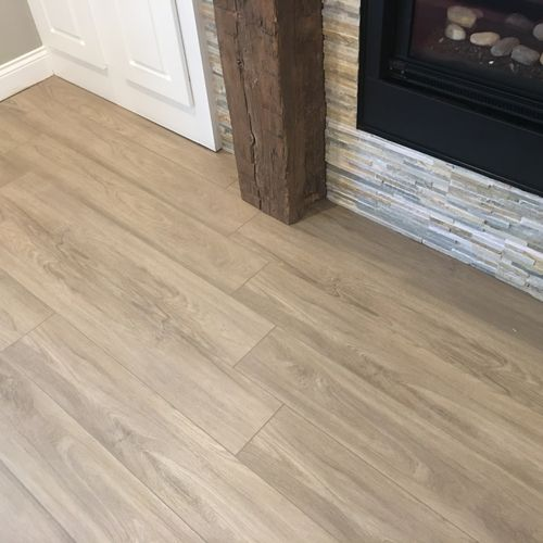 Luxury Vinyl Plank - this colors looks gorgeous next to this barn wood and natural stone.