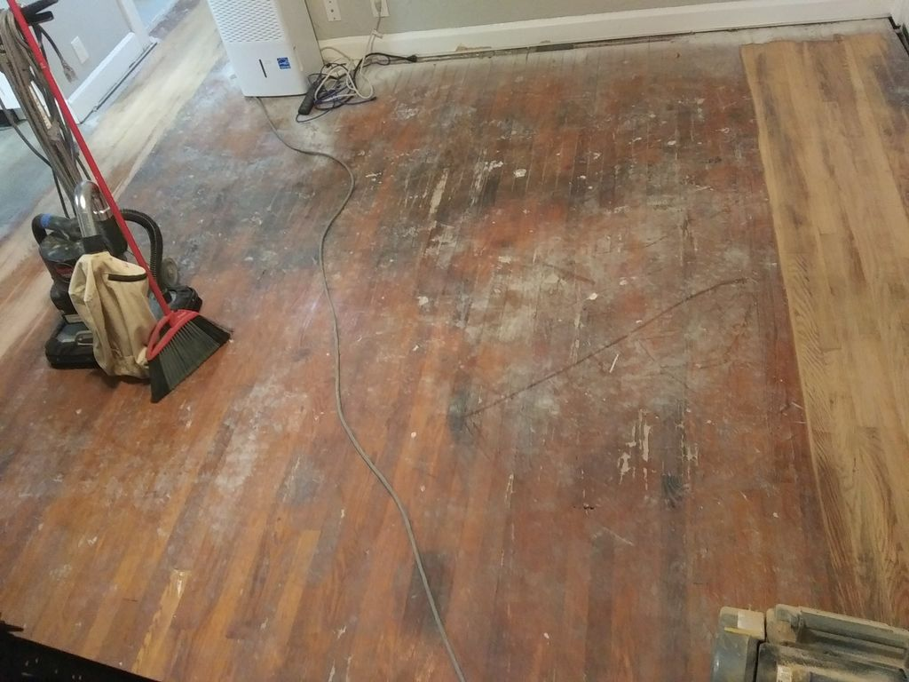 Damaged woos floor due to vinly click n lock plank install