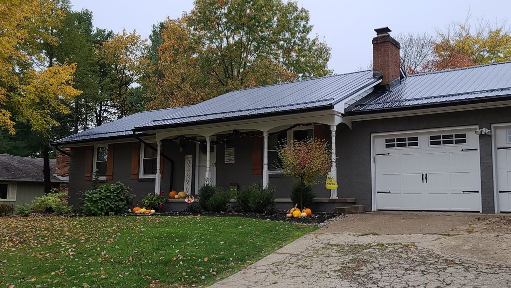 Metal roof with matching black gutters