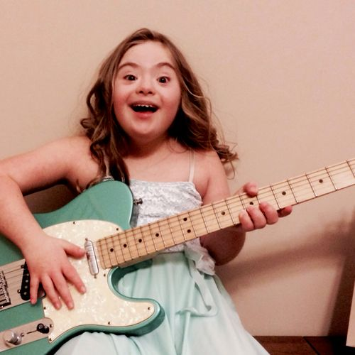 This is Miyah. She's my daughter with down syndrome and she loves the guitar!!