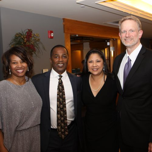 Posing with wife Raye and College Professor and spouse after speaking.