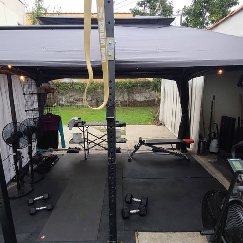tented off area connected to garage gym.