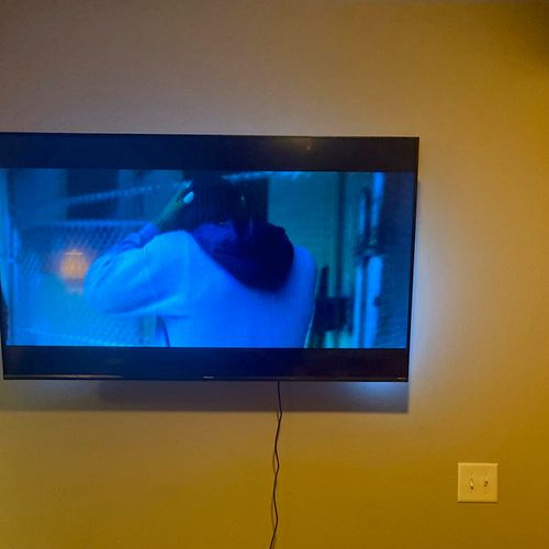 Mounted a 55in Roku TV with a tilt mount provided by customer. Customer also provided LED lights that were added as well.