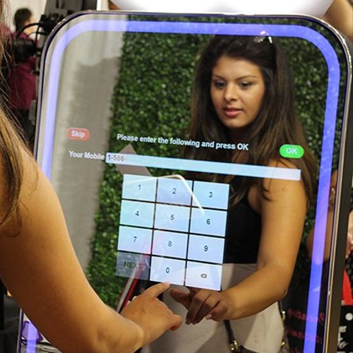 Guests will enjoy interacting with the Mirror Booth all while seeing their reflection.