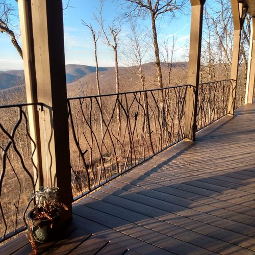 """hand forged """"branches"""" blending with scenic mountain backdrop"""