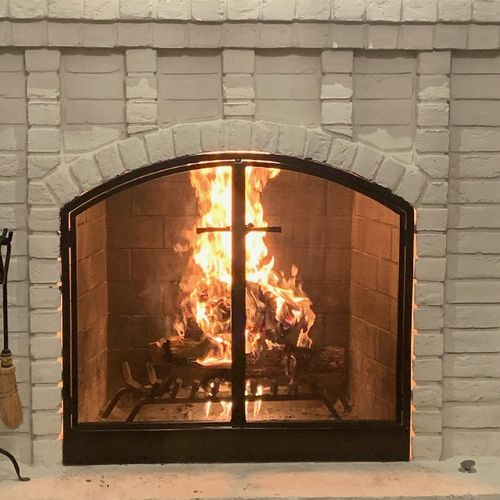 custom arched fireplace doors