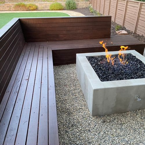 Firepit with wood bench and ground cover