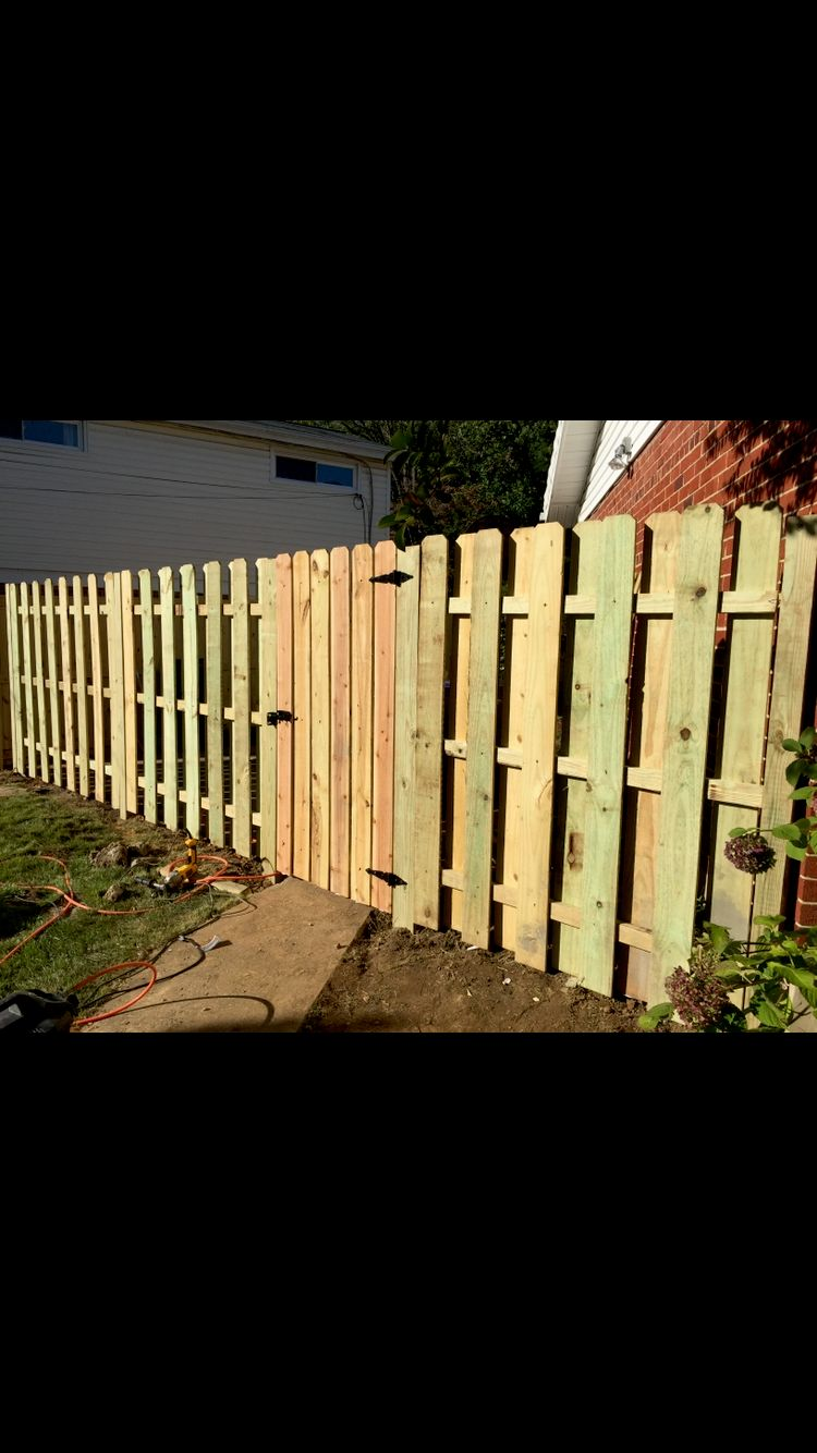 Shadow-box dog eared fence